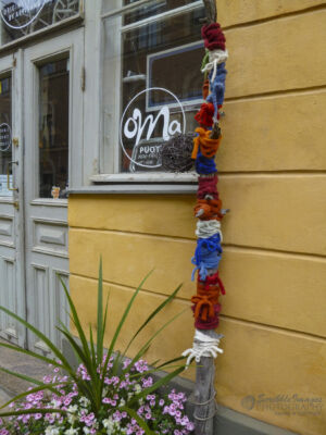 "Yarn-Bomb Pole outside of the ""Oma puoti"" artisan shop, Wanha Bock, Katariinankatu 4 b"